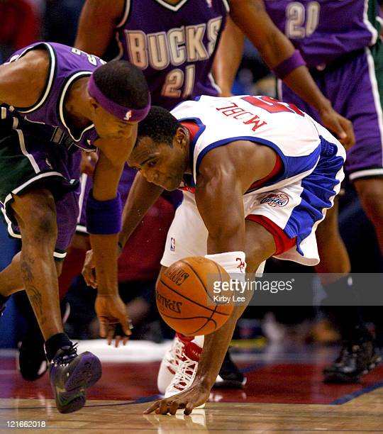 TJ Ford of the Milwaukee Bucks and Cuttino Mobley of the Los Angeles Clippers battle for loose ball during NBA game at the Staples Center in Los...