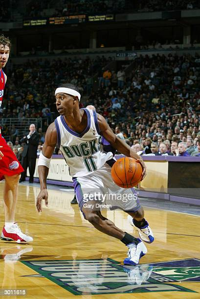 J Ford of the Milwaukee Bucks drives against the Los Angeles Clippers during the game at Bradley Center on February 21 2004 in Milwaukee Wisconsin...