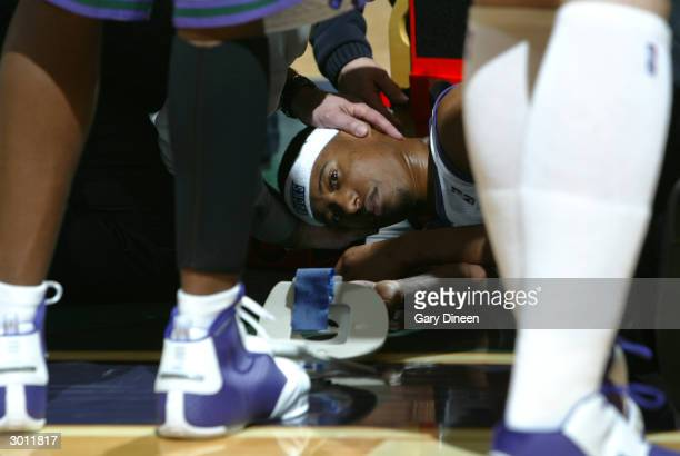 J Ford of the Milwaukee Bucks is tended by paramedics after an injury forces him from the game against the Minnesota Timberwolves on February 24 2004...