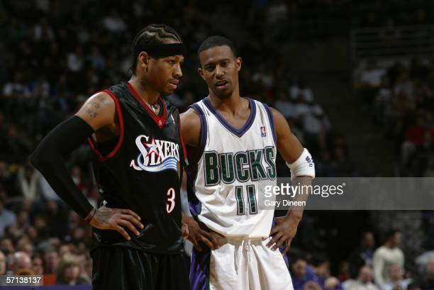 J Ford of the Milwaukee Bucks talks to Allen Iverson of the Philadelphia 76ers on February 24 2006 at the Bradley Center in Milwaukee Wisconsin The...
