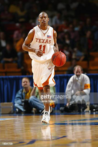 J Ford of the University of Texas Longhorns advances the ball against the University of North CarolinaAsheville Bulldogs during the first round of...