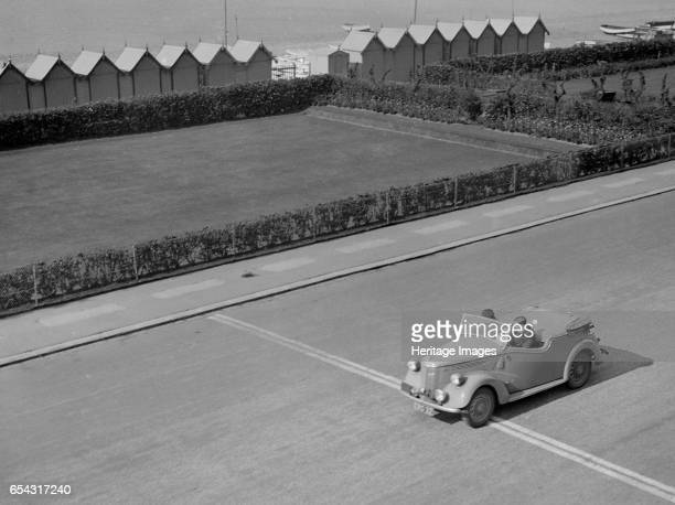 Ford Prefect tourer of JW Whalley competing in the RAC Rally Madeira Drive Brighton 1939 Artist Bill Brunell Ford Prefect tourer 1172 cc Vehicle Reg...