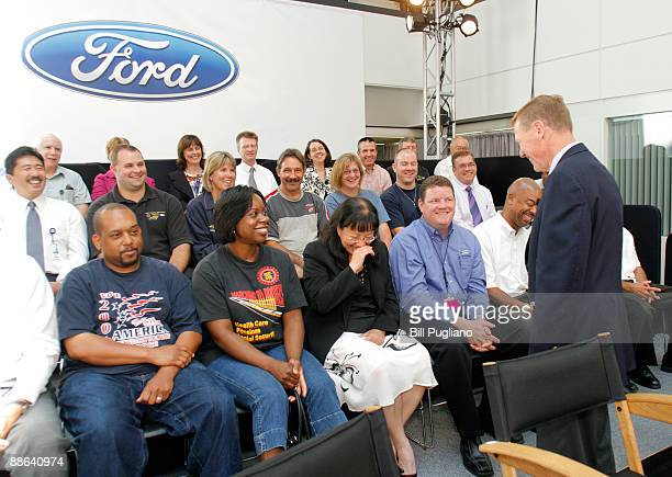 Ford President and CEO Alan Mulally jokes with Ford employees after an event where it was announced that the government, through the U.S. Department...