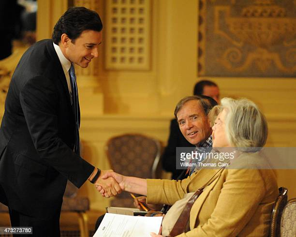 Ford President and CEO Mark Fields greets shareholders at the start of the Ford 60th Annual Meeting of Shareholders at the Hotel DuPont on May 14...