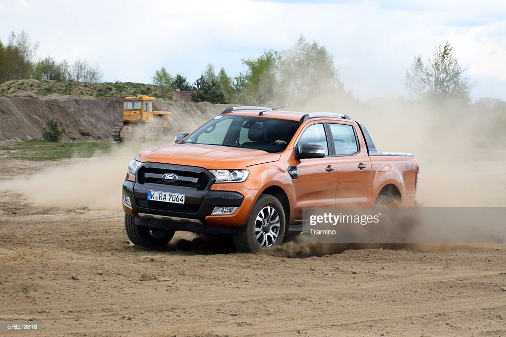 Ford Ranger driving on the unmade road : Stock Photo
