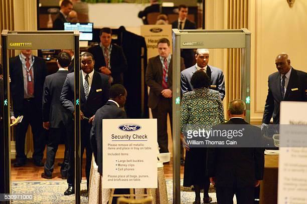 Ford shareholders go through security after checking in for the Ford 61st Annual Meeting of Shareholders at the Hotel DuPont on May 12 2016 in...