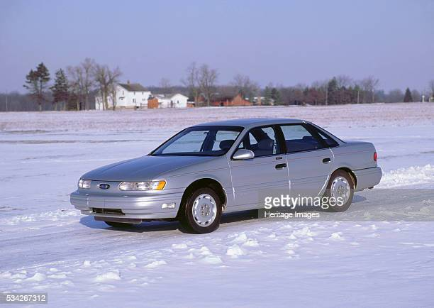 Ford Taurus in snow covered field 2000