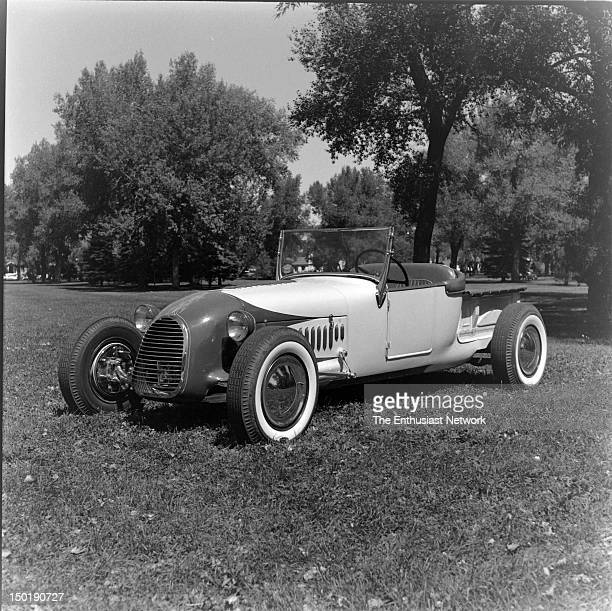 Ford tracknose roadster parked in an open grassy area with shade trees in the background