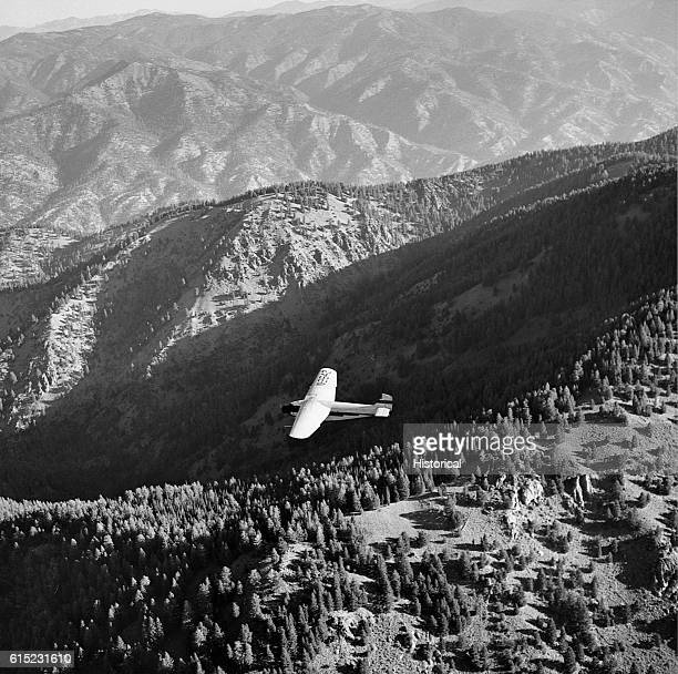 A Ford TriMotor plane approaches the Virginia Gulch Fire to drop smokejumpers Salmon National Forest Idaho USA