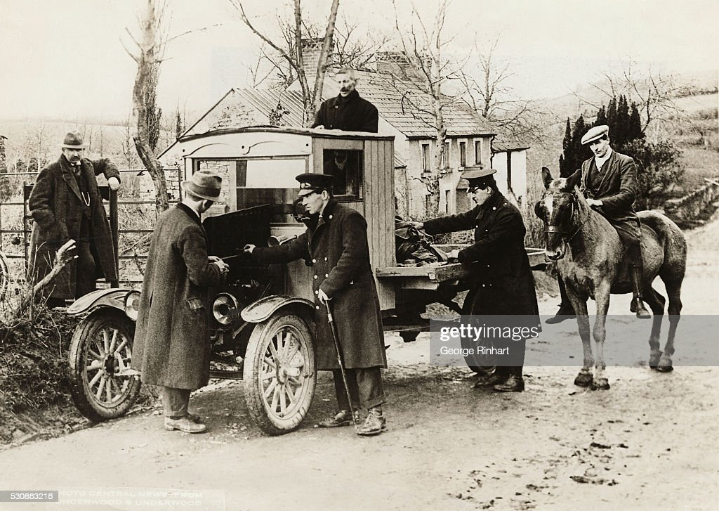 A Ford truck returning from North, Ireland is stopped at the Irish Free State border by Free State customs officers and subjected to thorough search, as are all persons and vehicles crossing the line now in effort to prevent smuggling of goods under new Free State tariff laws.