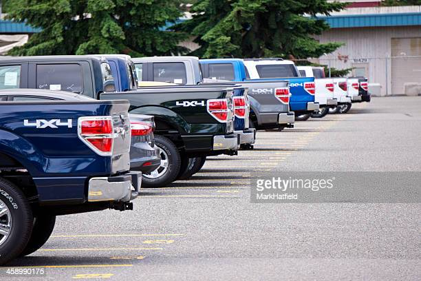 Ford Trucks Parked In Numbered Spaces