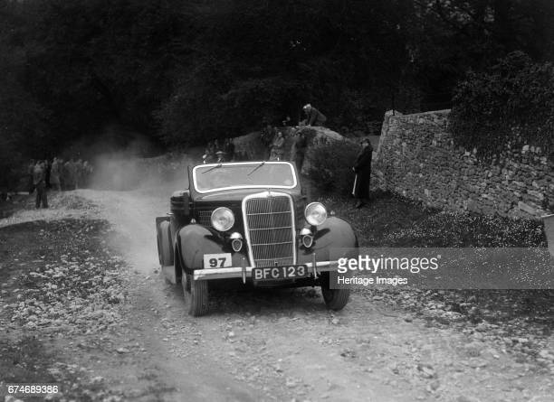 Ford V8 drophead competing in a motoring trial Nailsworth Ladder Gloucestershire 1930s Artist Bill Brunell