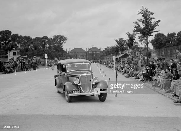 Ford V8 saloon of AE Harris competing in the South Wales Auto Club Welsh Rally 1937 Artist Bill Brunell Ford V8 Saloon 1934 Vehicle Reg No KG4894...