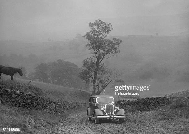 Ford V8 saloon of AKB Clarkson competing in the MCC Sporting Trial 1935 Artist Bill BrunellFord V8 Saloon 1934 3622 cc Vehicle Reg No WG2822 Event...