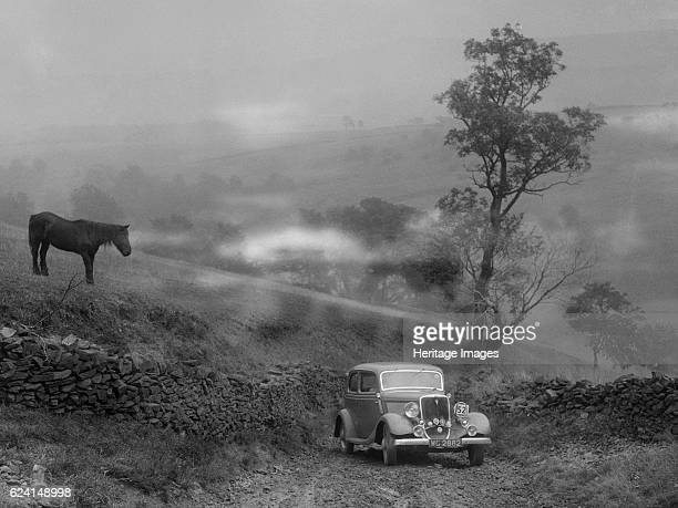 Ford V8 saloon of RE Alexander competing in the MCC Sporting Trial 1935 Artist Bill BrunellFord V8 Saloon 1934 3622 cc Vehicle Reg No WG2882 Event...
