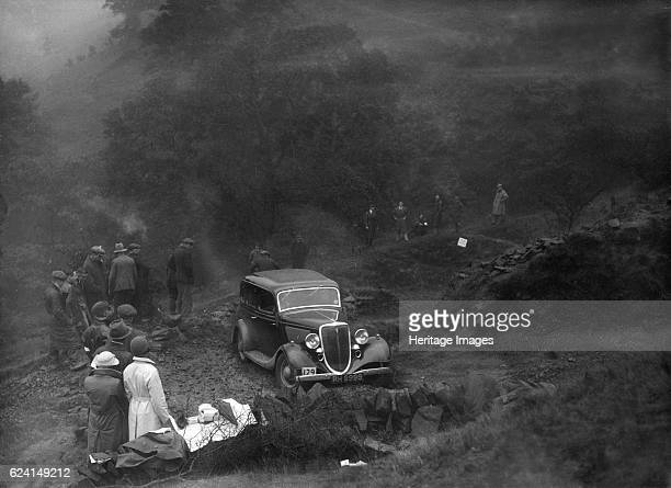 Ford V8 saloon of TC Wise competing in the MCC Sporting Trial 1935 Artist Bill BrunellFord V8 Saloon 1934 3622 cc Vehicle Reg No RH9999 Event Entry...