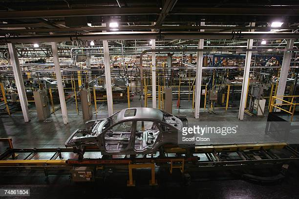 Ford vehicle during the early phases of construction rides along the assembly line at the Torrence Avenue Ford Assembly Plant June 22, 2007 in...