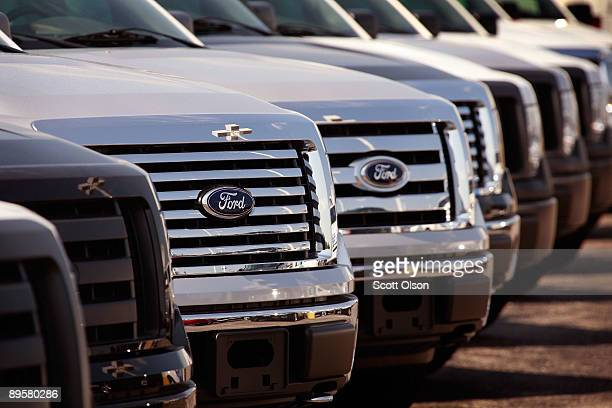 """Ford vehicles are offered for sale at a dealership August 3, 2009 in Countryside, Illinois. With the help of the U.S. Government's """"Cash for..."""