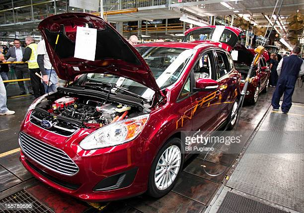 Ford workers assemble a CMAX hybrid vehicle at the Michigan Assembly Plant November 8 2012 in Wayne Michigan The plant is the only one in the world...