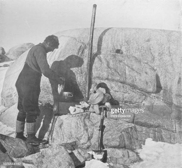 Forde Cooking SealFry on the Blubber Stove at Cape Roberts' circa 1911 The final expedition of British Antarctic explorer Captain Robert Falcon Scott...