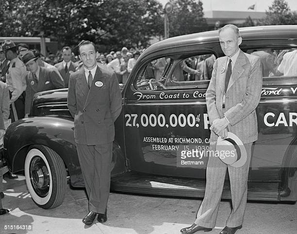 Fords Greet Car No. 27 000 at New York World's Fair. New York, New York: Henry Ford and his son, Edsel shown with the 27 000th Ford car, which was...