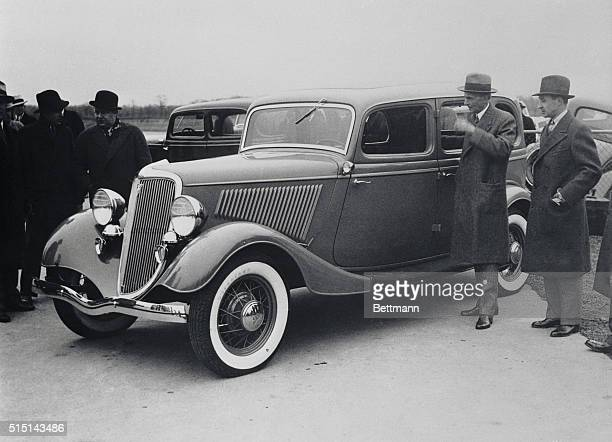 Ford's New Car Makes Debut Here is the new 1934 Model Ford VEight with new radiator design as it was previewed by a party of newspapermen at Detroit...