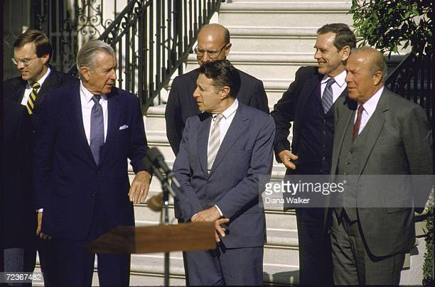 Chief of Staff Don Regan Def Secretary Cap Weinberger and Secretary of State George Shultz during ceremony at the White House