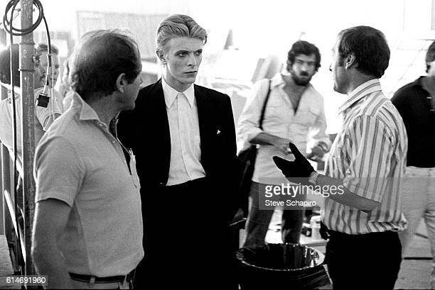 Fore, from left, English film director Nicolas Roeg, musician and actor David Bowie , and American actor Rip Torn on the set of their film 'The Man...