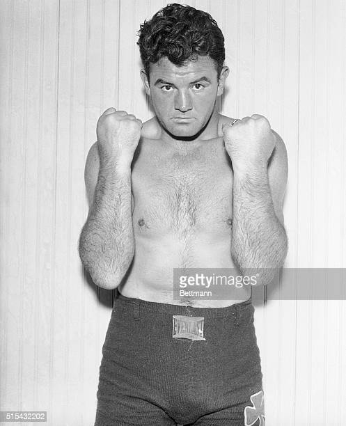 Forearmed is forearmed as far as Jim Braddock is concerned Photographed at his Kenosha Wisc training camp the champ is beginning to taper off...