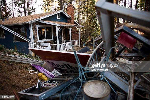 A foreclosed home awaits cleanup December 2 2008 in Somerset California Many foreclosed homes need substantial repairs and trash removal before going...
