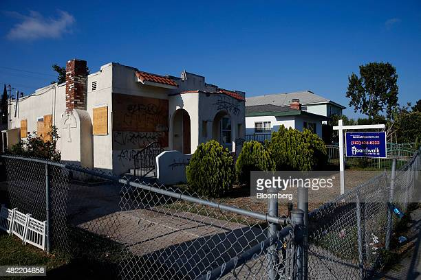 A foreclosed home covered in graffiti stands on Elizabeth Street in Compton California US on Monday July 6 2015 It can be a letdown for LA Hood Life...