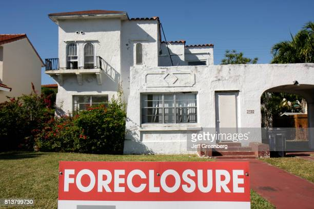 A foreclosure sign in front of a house on Alton Road