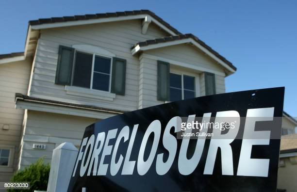 Foreclosure sign is posted in front of a home for sale April 29, 2008 in Stockton, California. As the nation continues to see widespread home loan...