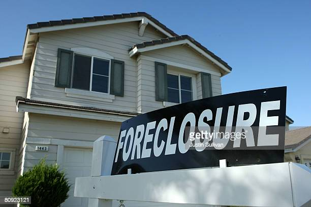 Foreclosure sign sits in front of a home for sale April 29, 2008 in Stockton, California. As the nation continues to see widespread home loan...
