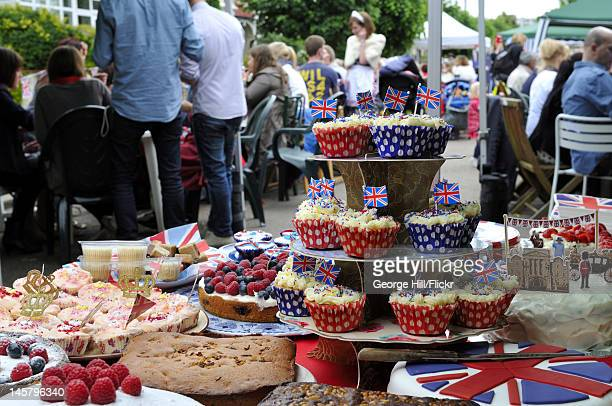 Foreground display of patriotic and royally themed homemade cakes to be consumed by the residents of Melbourne Road, Wimbledon, South West London...