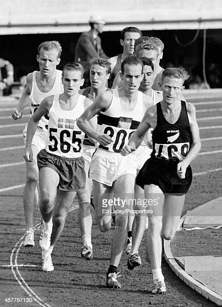 Bengt Najde of Sweden Harald Norpoth of Germany the eventual silver medallist and Murray Halberg of New Zealand running in the third heat of the...