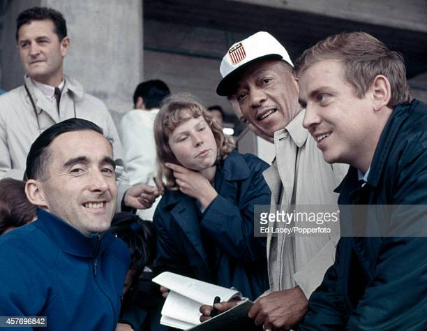 Foreground, left to right: veteran Olympic track athletes Gordon Pirie of Great Britain, Jesse Owens of the United States and Armin Hary of Germany,...