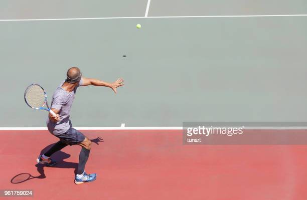 forehand stroke of a tennis player - tennis player stock pictures, royalty-free photos & images