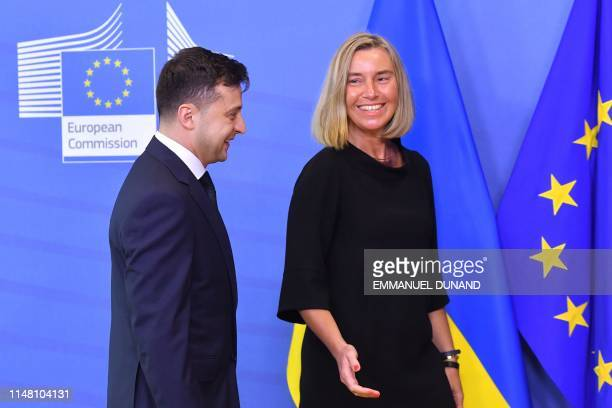 EU foreign affairs chief Federica Mogherini welcomes Ukraine's President Volodymyr Zelensky as he arrives at the European Commission in Brussels on...