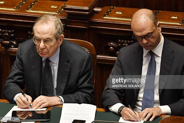 Foreign Affairs Minister Angelino Alfano and Economy and Finance Minister Pier Carlo Padoan are pictured before a confidence vote to the new...
