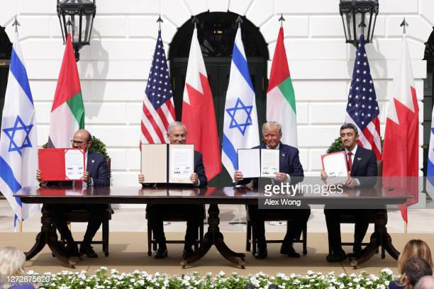 Foreign Affairs Minister of Bahrain Abdullatif bin Rashid Al Zayani, Prime Minister of Israel Benjamin Netanyahu, U.S. President Donald Trump, and...