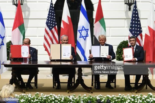 Foreign Affairs Minister of Bahrain Abdullatif bin Rashid Al Zayani, Prime Minister of Israel Benjamin Netanyahu, U.S. President Donald Trump and...