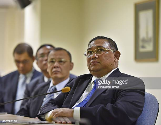 Foreign Affairs Minister of Myanmar Wunna Maung Lwin listens to an Indian Foreign Service officer at the Indian Foreign Service Institute on July 15...