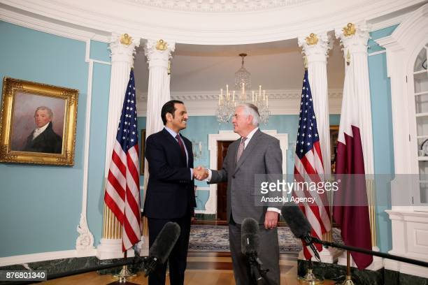 Foreign Affairs Minister of Qatar Mohammed bin Abdulrahman Al Thani and US Secretary of State Rex Tillerson shake their hands during their meeting at...