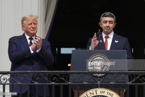 Foreign Affairs Minister of the United Arab Emirates Abdullah bin Zayed bin Sultan Al Nahyan speaks as US President Donald Trump looks on during the...