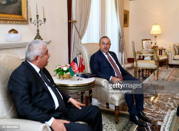 Foreign Affairs Minister of Turkey Mevlut Cavusoglu and First Vice President of Afghanistan Abdul Rashid Dostum chat during their meeting in Ankara...