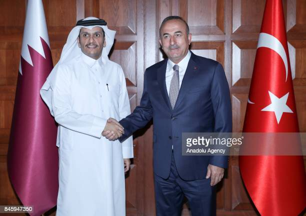 Foreign Affairs Minister of Turkey Mevlut Cavusoglu shakes hands with Foreign Affairs Minister of Qatar Mohammed bin Abdulrahman Al Thani as they...