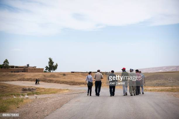 Foreign aid worker and Kurdish men socializing in Dubardan, northern Iraq