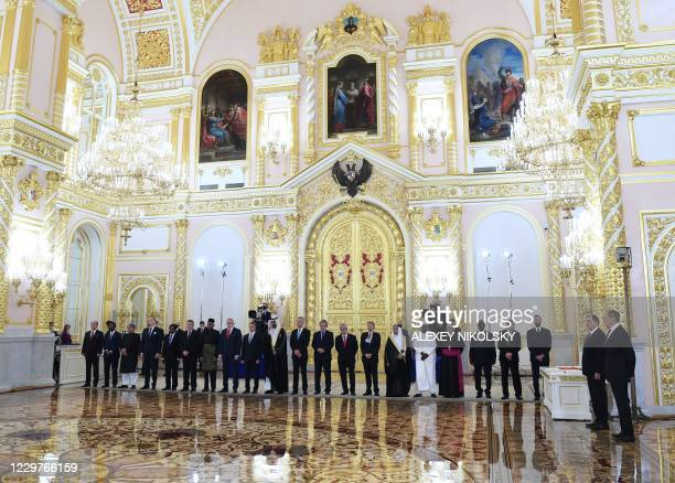 Foreign ambassadors attend a ceremony to present credentials to the Russian President at the Moscow Kremlin's Alexander Hall in Moscow on November 24...