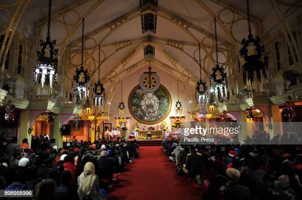 Foreign and local worshipers join priests and nuns attending a Christmas Eve special holy Mass and prayers at Catholic Assumption Church in Dhobighat...